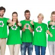 Stock Photo: People in recycling symbol t-shirts gesturing thumbs up