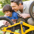 Father and son fixing bike — Stock Photo #39181743