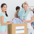 Stock Photo: People with clothes donation