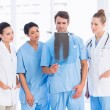 Group of doctors and surgeons examining x-ray — Stock Photo