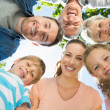 Extended family forming huddle in park — Stock Photo