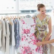 Young women shopping in clothes store — Stock Photo