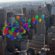 Many colourful balloons above city — Stock Photo #39182651