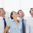 Smiling business team looking up — Stock Photo