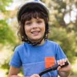 Cute little boy wearing bicycle helmet — Stock Photo #39183271