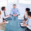Executives sitting around conference table — Stock Photo #39183639