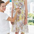 Female fashion designer measuring model — Stock Photo #39184427