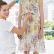 Female fashion designer measuring model — Stock Photo