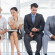Foto Stock: Four business people waiting for job interview