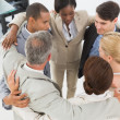 Zdjęcie stockowe: Diverse business team hugging in circle