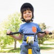 Cute little boy riding a bicycle — Stock Photo