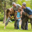 Family playing in park — Stock Photo
