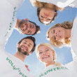 Happy volunteers forming a huddle against blue sky — Stock Photo