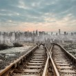 Railway tracks leading to big city — Stock Photo #39186321