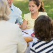 Family dining at outdoor table — Stock Photo