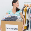 Stock Photo: Womwith clothes donation