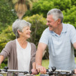 Stock Photo: Senior couple on cycle ride at park