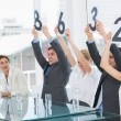 Judges in a row holding score signs — Stock Photo
