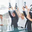 Stock Photo: Judges in a row holding score signs