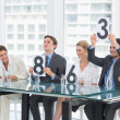 Judges in a row holding score signs — Stock Photo #39187431