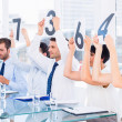 Group of panel judges holding score signs — Stock Photo #39187565