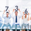 Group of panel judges holding score signs — Stock Photo #39187645