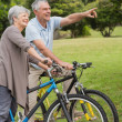 Senior couple on cycle ride in countryside — Stock Photo #39187663