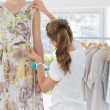 Stock Photo: Female fashion designer measuring model