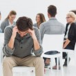 Stock Photo: Therapy in session sitting in circle while min foreground