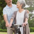 Senior couple on cycle ride at park — Stock Photo #39187853