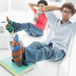 Relaxed casual couple with legs on desk in office — Stock Photo #39187933