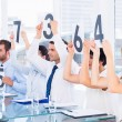 Froup of panel judges holding score signs — Stock Photo #39188409