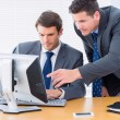 Businessmen using computer at office desk — Stockfoto #39188587