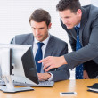 Businessmen using computer at office desk — Foto Stock #39188587