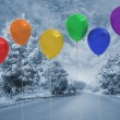 Stock Photo: Balloons above road