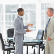 Businessmen speaking in conference room — Stock Photo #39189043
