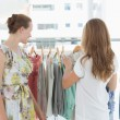 Young women shopping in clothes store — Stock Photo #39189117