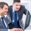 Businessmen using computer at office desk — Stock Photo #39189397