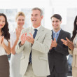Business team standing and clapping — Stock Photo #39189509