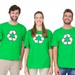 Young people wearing recycling symbol t-shirts — Stock Photo #39189743