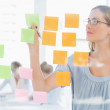Stock Photo: Concentrated artist looking at colorful sticky notes