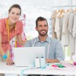 Fashion designers at work in bright studio — Foto Stock