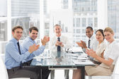 Business people clapping the camera at a meeting — Stock Photo