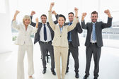 Successful business team clenching fists — Stock Photo
