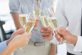 Hands toasting with champagne — Stock Photo