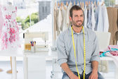 Handsome male fashion designer in studio — Stock Photo