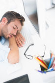 Male artist with head resting on keyboard — Stock Photo