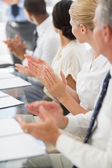 Business people clapping colleague at a meeting — Stock Photo