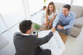 Young couple in meeting with a financial adviser — Stock Photo