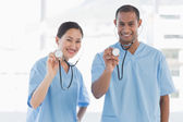Doctors with stethoscopes in hospital — Stock Photo